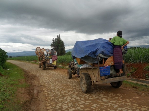 Refugees flee in trucks from Kachin state after fighting broke out in June 2011. (Reuters)