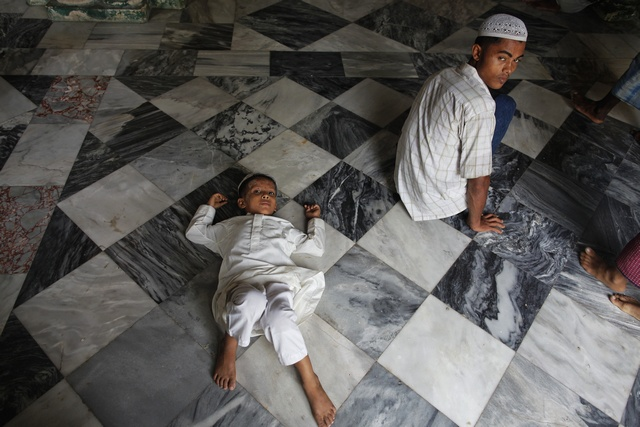 Rohingya worshippers gather for Friday prayers in Sittwe on 18 May 2012. (Reuters)