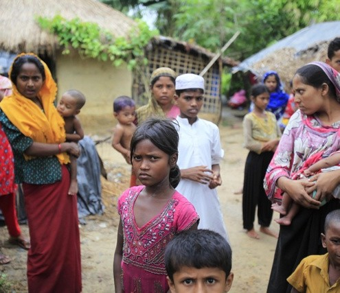 Rohingya refugees from Myanmar gather in an unregistered Rohingya refugee camp in Teknaf.