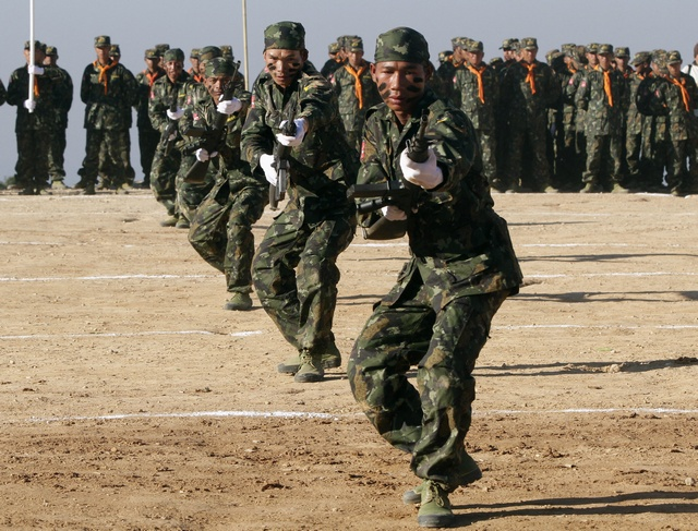 Shan State Army-South soldiers demonstrate their skills during the 65th anniversary of Shan State National Day at the army's Loi Taileng headquarters along the Burmese-Thai border on 7 February 2012. (Reuters)