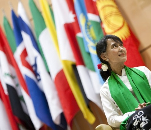 Myanmar's pro-democracy leader Suu Kyi waits to deliver a speech during the last day of the 101st session of the International Labour Conference in Geneva
