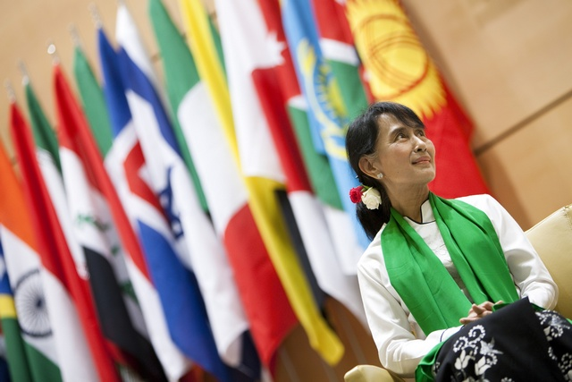 Suu Kyi waits to deliver a speech during the last day of the 101st session of the International Labour Conference in Geneva (Reuters)
