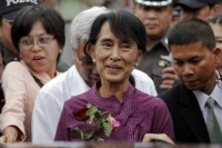 Suu Kyi visits the Nationality Verification Centre for migrant workers from Burma in Samut Sakhon province during her visit to Thailand in 2012. (Reuters)