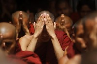 Arakanese Buddhist monks pray for peace at the Sule pagoda in central Rangoon on 12 June 2012. (PHOTO: Reuters)