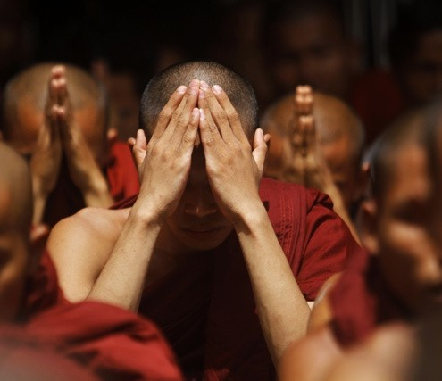 Rakhine Buddhist monks pray for peace at the Sule pagoda in central Yangon