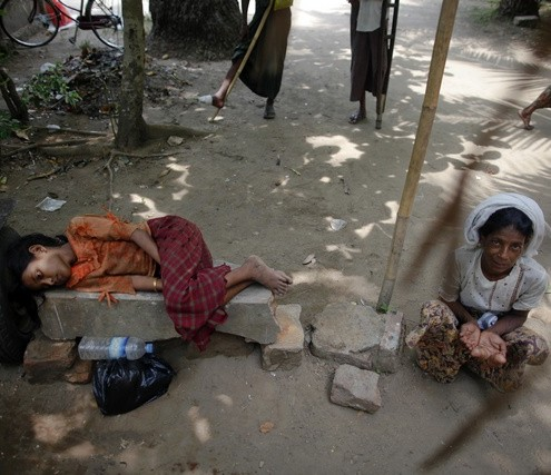 Myanmar Rohingyas wait for aid outside a mosque after the Friday prayers in Sittwe