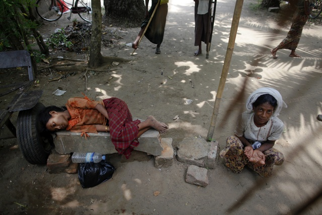 Rohingyas wait for aid outside a mosque after the Friday prayers in Sittwe on 18 May 2012. (Reuters)