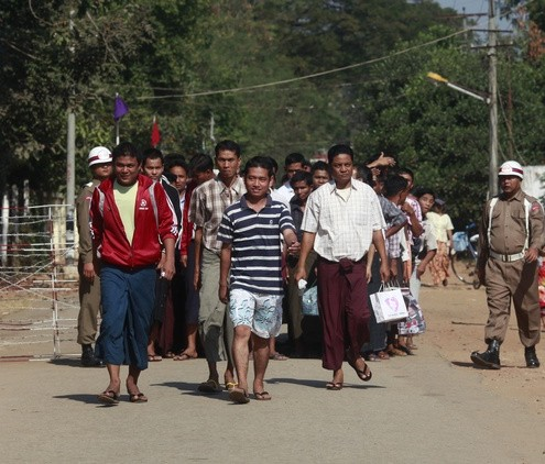Prisoners come out from Insein prison after authorities released them in Yangon