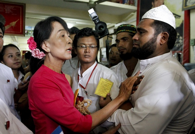 In this file photo from June 2012, Aung San Suu Kyi talks to Muslim leaders at the NLD head office in Rangoon as they appeal to her to intervene following a wave of anti-Muslim attacks in Arakan State. (PHOTO: Reuters)