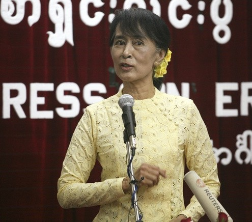 Myanmar's opposition leader Aung San Suu Kyi gestures as she talks during a news conference about her Europe tour, at her party's headquarters in Yangon