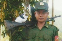 File photo of a child soldier in Burma. The US State Department has decided to downgrade Burma in its annual report on human trafficking, in part because of the military's continuing practice of recruiting underage soldiers. (Photo: DVB)