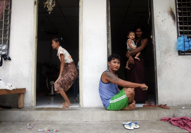 File photo of Burmese migrant workers passing time in the port town of Mahachai, near Bangkok in 2011. (PHOTO: Reuters)