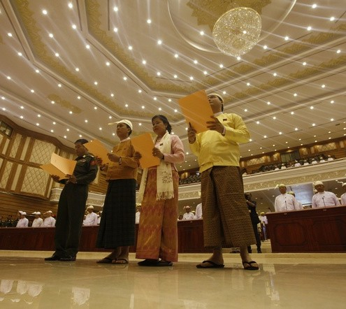 Four new lawmakers, three of whom belong to Aung San Suu Kyi&#039;s NLD party and one representing the military, take oath at the opening of the Lower House session in Naypyitaw