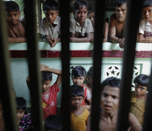 Myanmar Rohingya people gather at a local mosque before the Friday prayers in a village north of the town of Sittwe