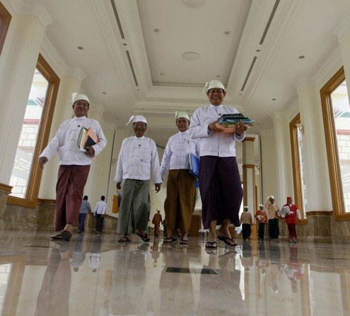Secretary-General of Myanmar&#039;s USDP Htay Oo walks with other members of parliament to opening of a joint parliament  session in Naypyitaw