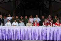 Burma's negotiation talks committee and their Karen National Union counterparts pose during a news conference after signing a ceasefire agreement in Pa-an, capital of the Karen State, on 12 January 2012. (Reuters)