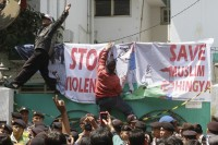 Muslim activists protest outside the Burmese embassy in Jakarta on 9 August 2012. (Reuters)
