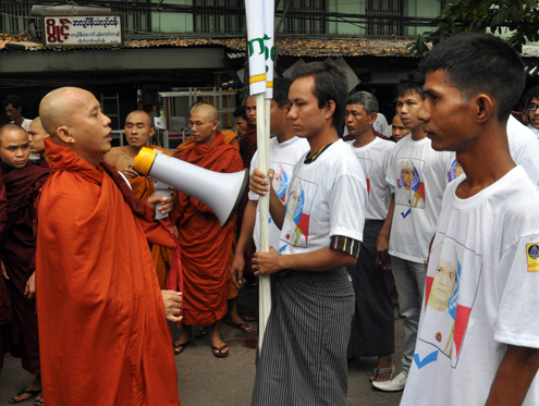 Demonstrators and monks march in support of a plan to deport the country's Rohingya population in Mandalay on 2 September 2012. (DVB)