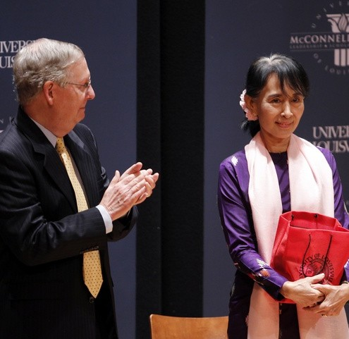 Aung San Suu Kyi stands on stage with U.S. Senators Mitch McConnell (R-KY) after she spoke at the McConnell Center on the campus of the University of Louisville in Louisville