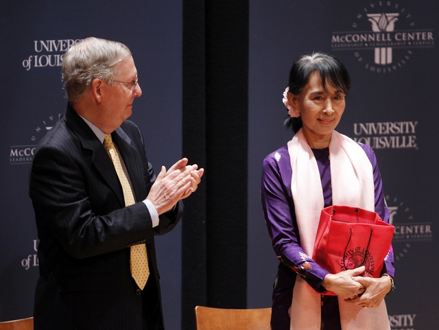 Aung San Suu Kyi stands on stage with US Senator Mitch McConnell after she spoke at the the University of Louisville in Louisville, Kentucky on 24 September 2012. (Reuters)