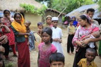 In this file photo from 2012, Rohingya refugees from Burma gather in an unregistered refugee camp in Teknaf, southern Bangladesh. (PHOTO: Reuters)