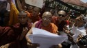 Buddhist monk reads a statement during a protest in front of the Bangladeshi embassy in Yangon
