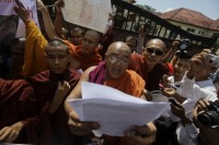 A Buddhist monk reads a statement during an earlier protest in Rangoon. Monks demonstrated against the recent attacks on Buddhist temples and homes in southeast Bangladesh, in front of the Bangladeshi embassy on 5 October 2012. (Reuters)