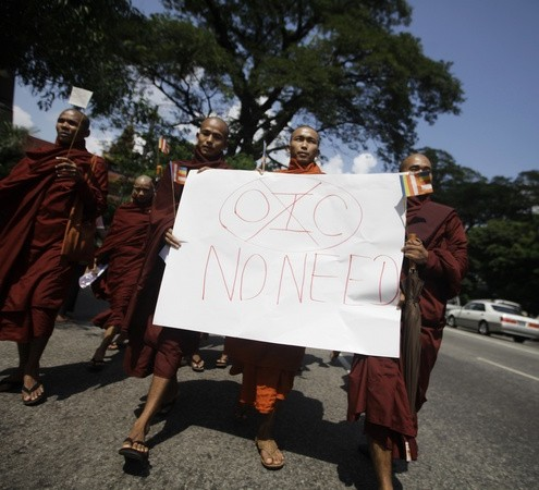 Buddhist monks hold a placard as they protest against the opening of Organizationof Islamic Cooperation offices in Myanmar