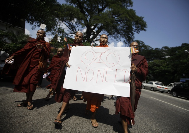 Buddhist monks hold a placard as they protest against the opening of Organization of Islamic Cooperation (OIC) offices in Burma, near Shwedagon Pagoda in Rangoon on 15 October 2012. (Reuters)