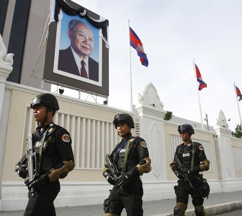 Cambodian government security forces walk in front of the Council of Ministers building as they patrol along a street ahead of the 21st ASEAN Summit and other related summits in Phnom Penh