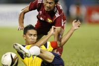 Brunei's Md Najib Tarif (bottom) and Burma's Thet Naing chase for the ball during the semi-final of the Hassanal Bolkiah Trophy for ASEAN Youth Football Tournament 2012 in Bandar Seri Begawan on 7 March 2012. (PHOTO: Reuters)
