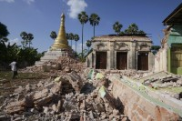 A man walks near a Buddhist pagoda that was badly damaged by an earthquake in the village of Ma Lar at Kyauk Myaung township on 11 November 2012. (Reuters)