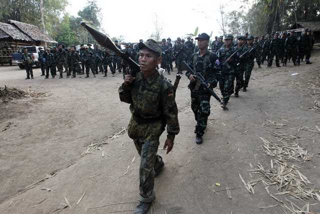 A file photo of Karen National Union soldiers marching in a procession during the 63rd anniversary of Karen Revolution Day at Oo Kray Kee township in Karen state on 31 January 2012.  (PHOTO: Reuters)