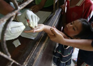 A child gets tested for malaria at a clinic on the Thai-Burmese border. Access to doctors and certified medicines is limited within Burma's under-served medical system. (PHOTO: Reuters)