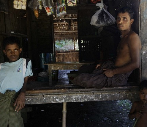 Muslim people pass the time at their house in Paik Thay, the site of recent violence between Muslim Rohingyas and Buddhist Rakhine people