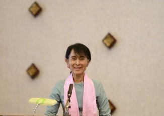 Aung San Suu Kyi gives a speech during a meeting of Rule of Law committee in Rangoon.