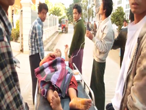 An injured monk is treated after authorities assaulted protestors near Latpaduang Copper Mine in Sagaing division's Monywa district on 29 November 2012. (DVBTV)