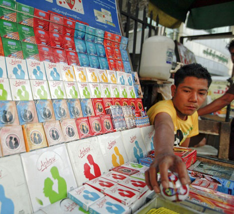 Man sells condoms in central Yangon