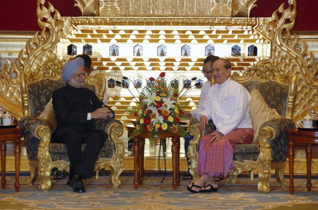 India's Prime Minister Singh talks with Burma's President Thein Sein during a meeting in Naypyitaw (Reuters)