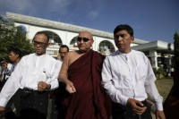 In this file photo, Min Ko Naing (R) and Mya Aye (L), leaders of 88 Generation Students, exit a hospital after meeting with injured Buddhist monks in Monywa on 1 December 2012. (PHOTO: DVB)