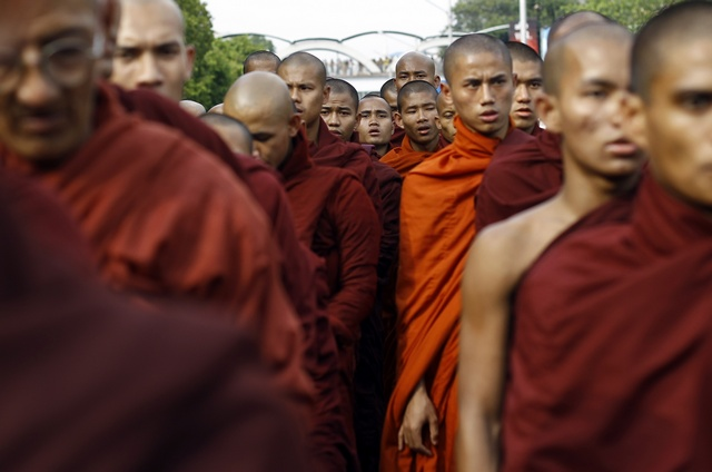 Buddhist monks take part in a protest in support of monks who were injured during a police assault on demonstrators at a copper mine in late November in Rangoon on 12 December 2012. (Reuters)