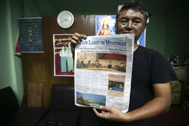 State-run newspaper The New Light of Myanmar. (PHOTO: Reuters)