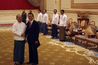 Japan's Deputy Prime Minister and Finance Minister Taro Aso (L) shakes hands with President Thein Sein as they meet in the capital Naypyidaw on 3 January 2013 (Reuters)