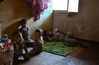 File photo of a displaced Kachin family huddling in their room at the Manaw camp in central Laiza, May 2012. (PHOTO: Hanna Hindstrom)