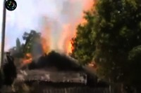 A Kachin house burns after coming under attack from the Burmese army on 31 December 2012 (DVB)