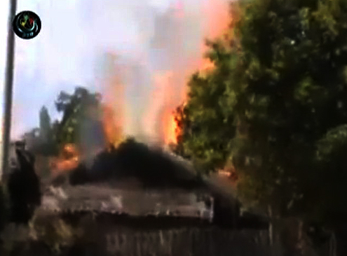 Kachin house burning