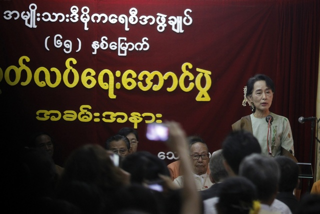 Aung San Suu Kyi gives a speech on the event of Myanmar's 65th Independence Day at the NLD head office in Rangoon (Reuters)