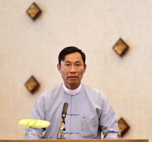 Shwe Man, speaker of Lower House of Parliament, gives a speech during a meeting of  Rule of Law and Peace and Stability Committee of House at Yangon Division Parliament in Yangon