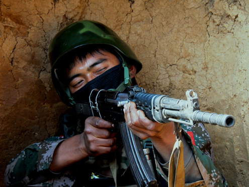 A Kachin soldier takes aim on the frontlines near Laiza in northern Kachin state. (DVB)