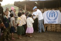 UN officials seen distributing aid to refugees in Laiza, Kachin state, in December 2011 (Ryan Libre / DAA)